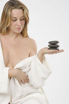 Girl Wearing Bathrobe With Zen Stone Royalty Free Stock Photo