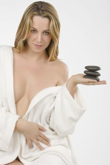 Girl Wearing Bathrobe With Zen Stone Royalty Free Stock Photography