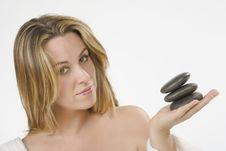 Free Girl Wearing Bathrobe With Zen Stone Stock Photography - 6187612
