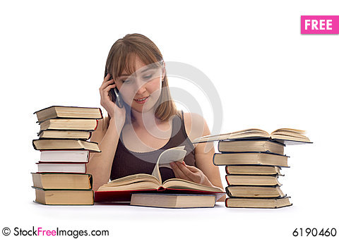 Free Young Woman And A Pile Of Books Stock Photo - 6190460