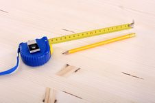 Wooden Plank And Measuring Tape Royalty Free Stock Photo