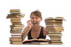 Young Woman And A Pile Of Books Royalty Free Stock Image