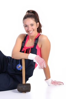 Woman With Black Rubber Mallet Royalty Free Stock Images