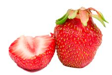 Close-up Whole And Half Strawberries Stock Photos