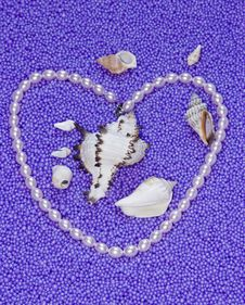 Free Heart From Pearls Beads On A Lilac Background Ex Stock Images - 6191084