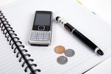 Free Pen,cellphone,coins And Notebook Royalty Free Stock Photos - 6193388
