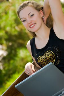 Happy Young Woman With Laptop Stock Photography