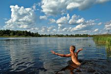 Free Boy Swimming In River Royalty Free Stock Images - 6195229