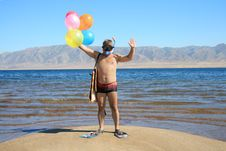 Free Man With Mask, Flippers And Balloons Is Salutation Stock Image - 6195901