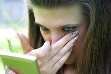 Free Girl Corrects Make-up Stock Photography - 6196252