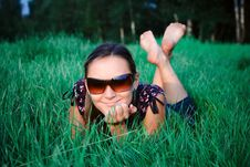 Free Young Girl Lying In Grass Stock Photos - 6199253
