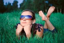 Free Young Girl Lying In Grass Stock Images - 6199274