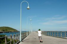 Man Standing On A Pier Royalty Free Stock Images