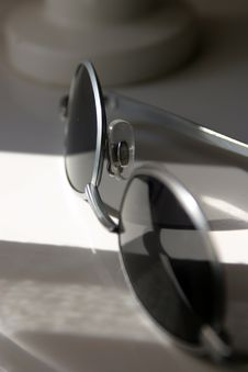 Free Sunglasses On Table In Sunlight Royalty Free Stock Photos - 621958