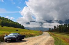 Car, Road And Skies. Stock Photo