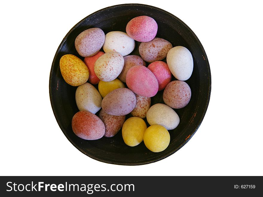 Mini candy chocolate eggs in a round dish (isolated)