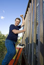 Free Man Repairing Siding - Vertical Stock Photography - 6201792