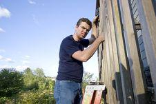 Free Man Repairing Siding - Horizontal Stock Photo - 6201820