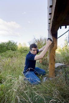Free Man Fixing House - Vertical Stock Photos - 6201893