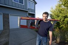Free Man With Ladder And Hammer - Horizontal Stock Image - 6202061