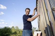 Free Man Repairing Siding - Horizontal Stock Photo - 6202090
