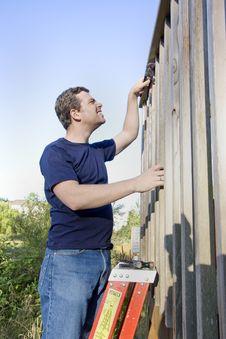 Free Man Repairing Siding - Vertical Stock Photos - 6202143