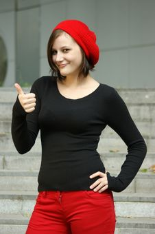 Free Girls With Red Cap Stretches Thumb In The Air Royalty Free Stock Photo - 6202145