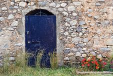 Blue Metallic Door On Stone Building Stock Photo