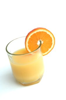 Glass Of Orange Juice And Segment Of An Orange Royalty Free Stock Photos