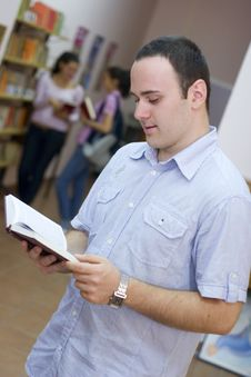 Young Student Holding Book Royalty Free Stock Photography