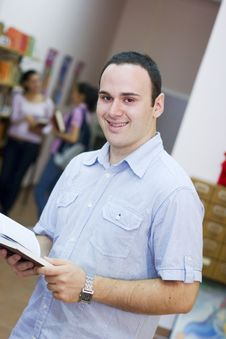 Free Young Student Holding Book Stock Image - 6203081