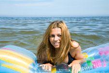 Free Beautiful Girl Swimming On Mattress Stock Photo - 6204040