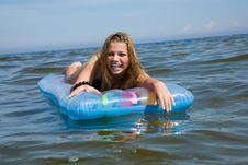 Free Beautiful Girl Swimming On Mattress Royalty Free Stock Photo - 6204075