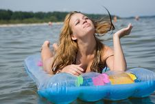 Free Beautiful Girl Swimming On Mattress Royalty Free Stock Photos - 6204108