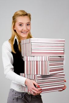 Free Smiling Young Woman With Stack Of Boxes Stock Photo - 6204210