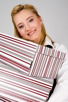 Free Smiling Young Woman With Stack Of Boxes Stock Image - 6204291