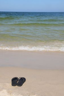 Free Black Sandals On A Beach Royalty Free Stock Image - 6204506