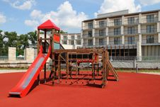 Playground In A Front Of Modern Building Stock Images