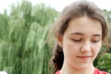 Free Smiling Teen Girl Looking Down Royalty Free Stock Images - 6205149