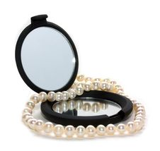 Pearl Beads And Mirror Royalty Free Stock Photography