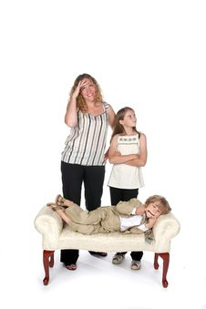 Free Mother And Daugheter Laughing At Boy On Couch Royalty Free Stock Photo - 6206975