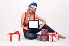 Free The Beautiful Blonde With Big Breasts Is Sitting On A White Back Royalty Free Stock Image - 62042856