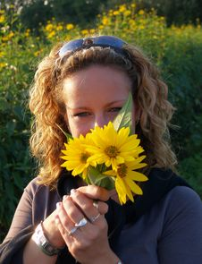 Curly Girl With Flowers Royalty Free Stock Image