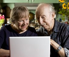 Free Senior Couple With A Laptop Computer Royalty Free Stock Image - 6213196