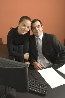 Businessman And Woman At A Desk - Vertical Stock Image