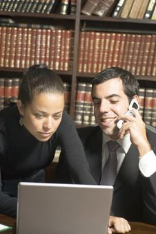 Businessman And Woman In Office - Vertical Stock Image