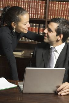 Free Businessman And Woman With Laptop - Vertical Royalty Free Stock Images - 6213599