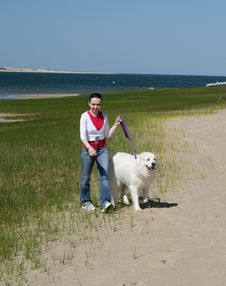 Girl And Dog. Great Pyrenees. Stock Images