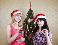 Two Young Women Near A Christmas Tree Stock Photo