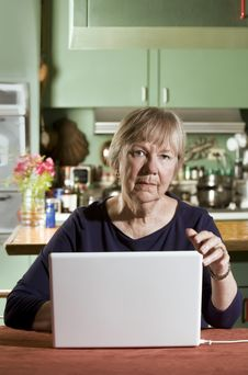 Free Senior Woman With A Laptop Computer Royalty Free Stock Image - 6228936